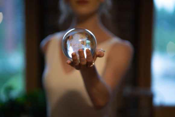 woman holding glass ball