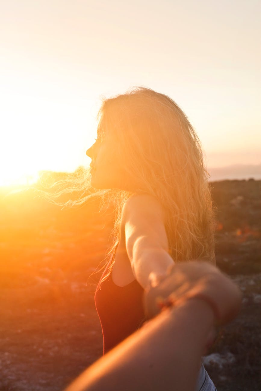 photo of a woman at sunset