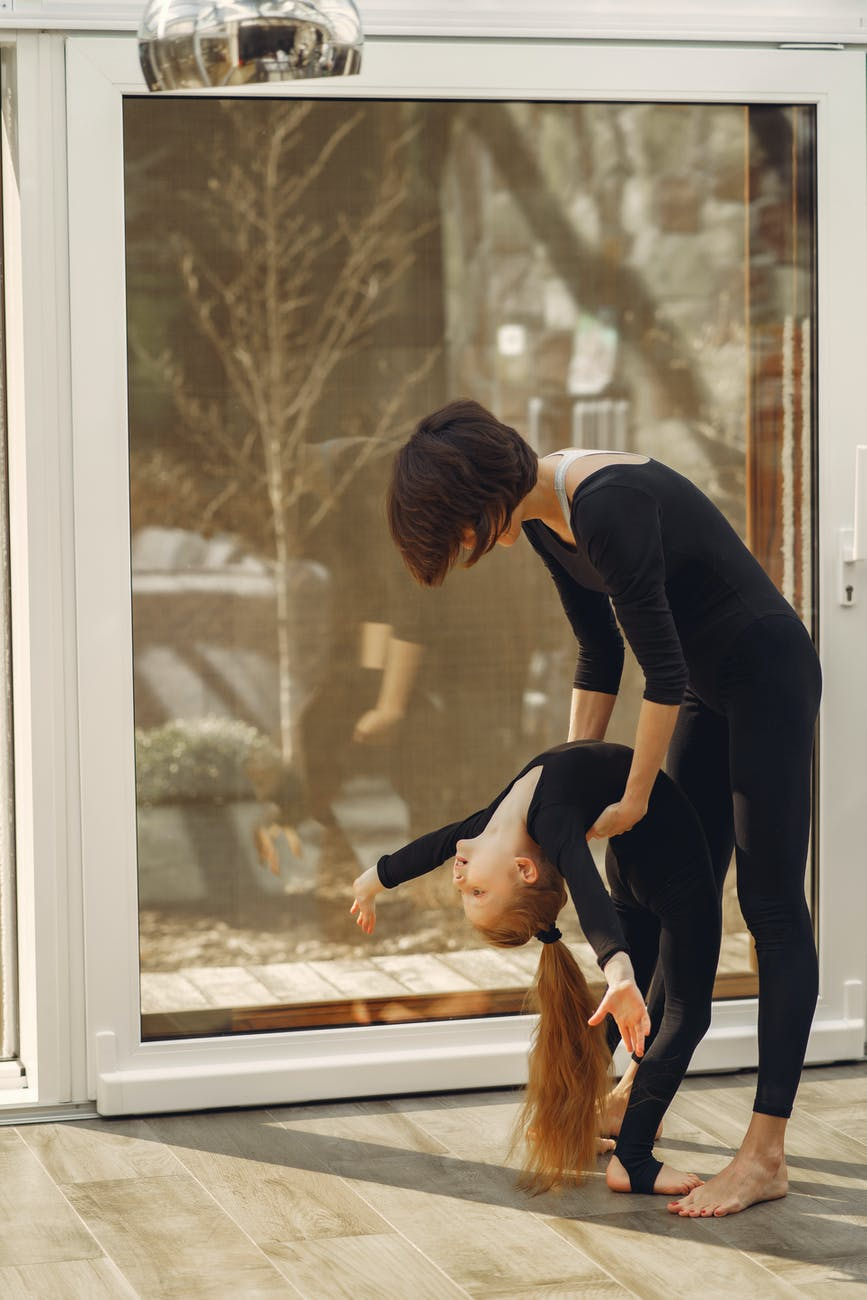 woman and little girl in black long sleeve shirt and black pants