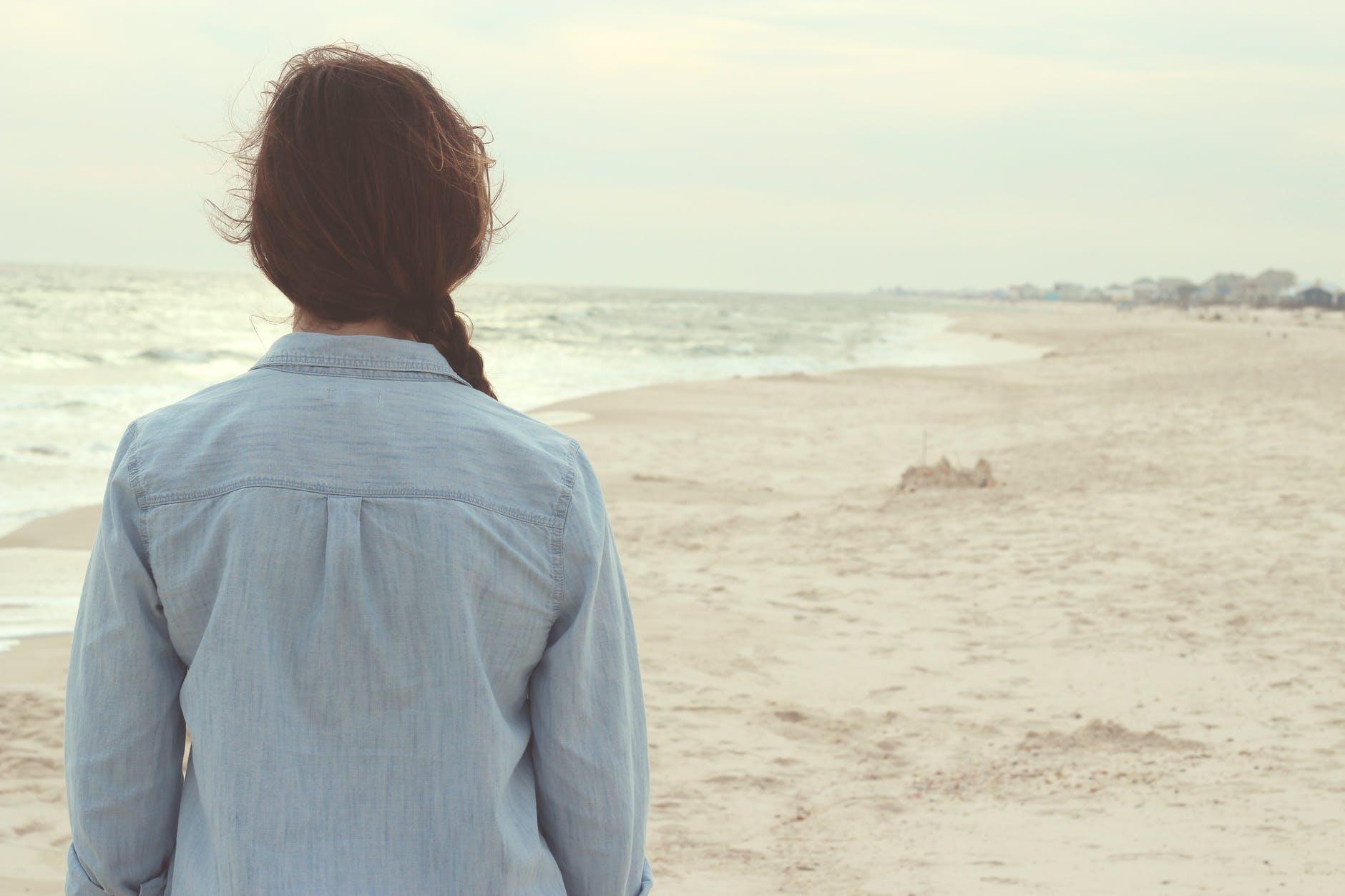 alone back beach girl