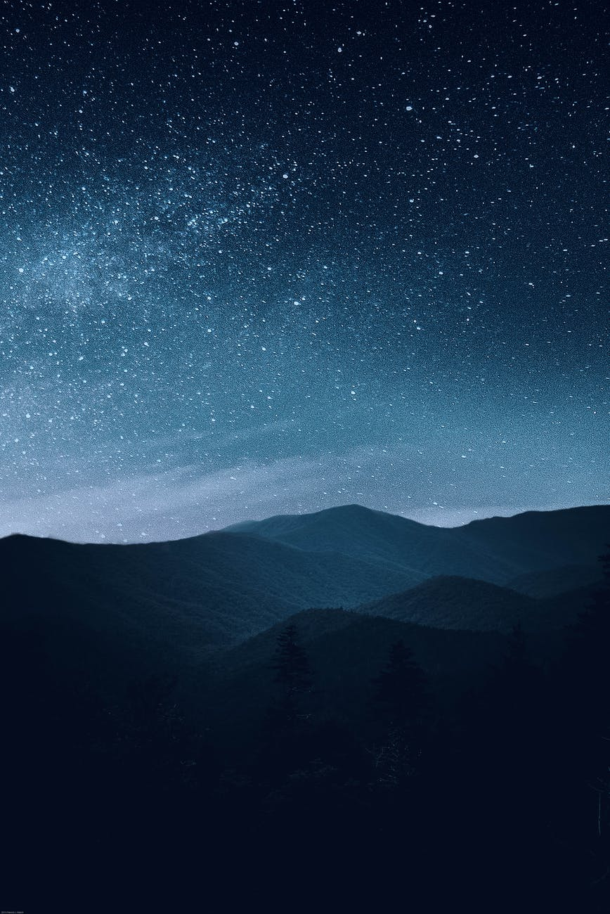 starry sky over mountains